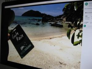 Schöne Reise: Die Kunden senden Urlaubsfotos aus der ganzen Welt mit einem Kofferanhänger von